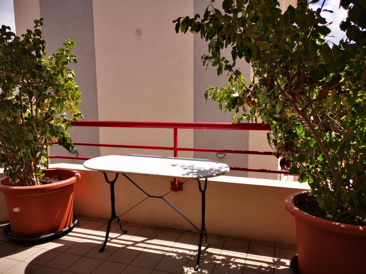 Centre-ville appartement plein sud balcon garage